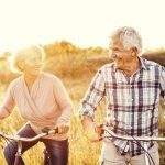 older adult couple biking
