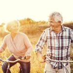 older adult couple biking