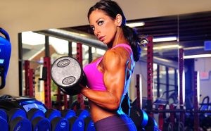 Bodybuilder and NPC Figure Competitor Danyelle Masterone doing bicep curl