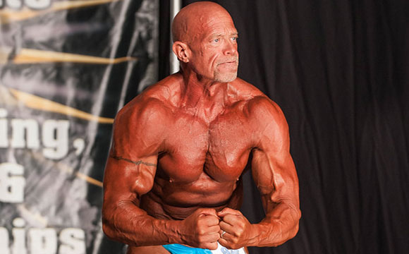 Masters Bodybuilder Tim Nassen flexing at