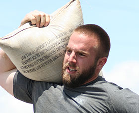 ASC Pro Strongman Spenser Remick doing sandbag carry