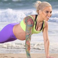 Fit Mom & WBFF Pro Carissa Johnson on beach exercising during pregnancy