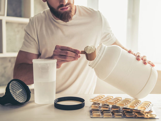 male mixing a protein shake