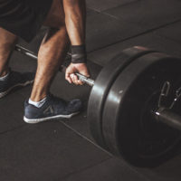 male athlete zoomed in view of him deadlifting / myhmb blog why you should deadlift by Brad Gillingham