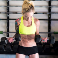 Carissa Johnson in a gym doing dumbbell curls / myhmb blog why women shouldn't be afraid of weights