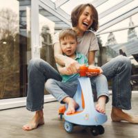 Mom with son on play scooter / myHMB blog Fit Tips for Busy Moms