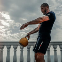 man doing a single arm kettlebell swing / myHMB blog Best Ways to Increase Your Endurance & Metabolic Conditioning by Mike Kurzeja
