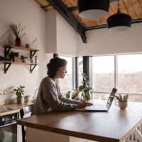 Woman working on her laptop from home / myHMB blog Balancing It All by Philita Scholz