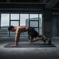 Man performing mountain climbers / myHMB blog Ways to Improve Mobility by Spenser Remick