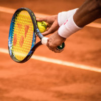 person Serving a tennis ball / myHMB Blog Training Tips from Coaches