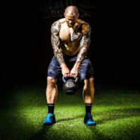 Man performing a kettlebell swing / Why the Kettlebell Swing is king myhmb blog by Brad Gillingham