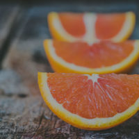 Building Strong Women / Nutrition 101 Blog / myHMB / Oranges on a table