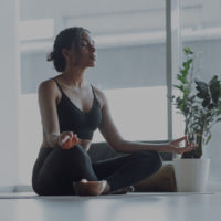 Woman mediating for A Shift in Active Nutrition News Artilce on myHMB.com
