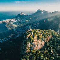Drone view of Rio De Janeiro, Brazil featuring the Christ the Redeemer statue