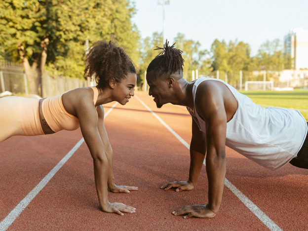 a couple at a track doing push-ups while facing eachother / myhmb blog back to the basics - the push-up by carissa johnson